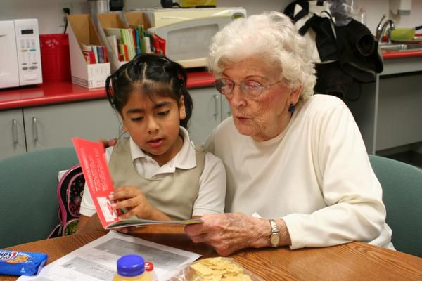 In this 2019 file photo, Emeritus at Farmers Branch resident Joan Hinton, 85, helps Maria Jose, 6, a student in Janie Stark Elementary School's Two Way Dual Language Program, read in English during a regular after-school tutoring session. The school is known for its community strength and support, in and out of the classroom.