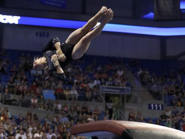 FILE - UCLA's Madison Kocian competes on the vault during the NCAA college women's gymnastics championships, Saturday, April 15, 2017, in St. Louis. (AP Photo/Jeff Roberson)