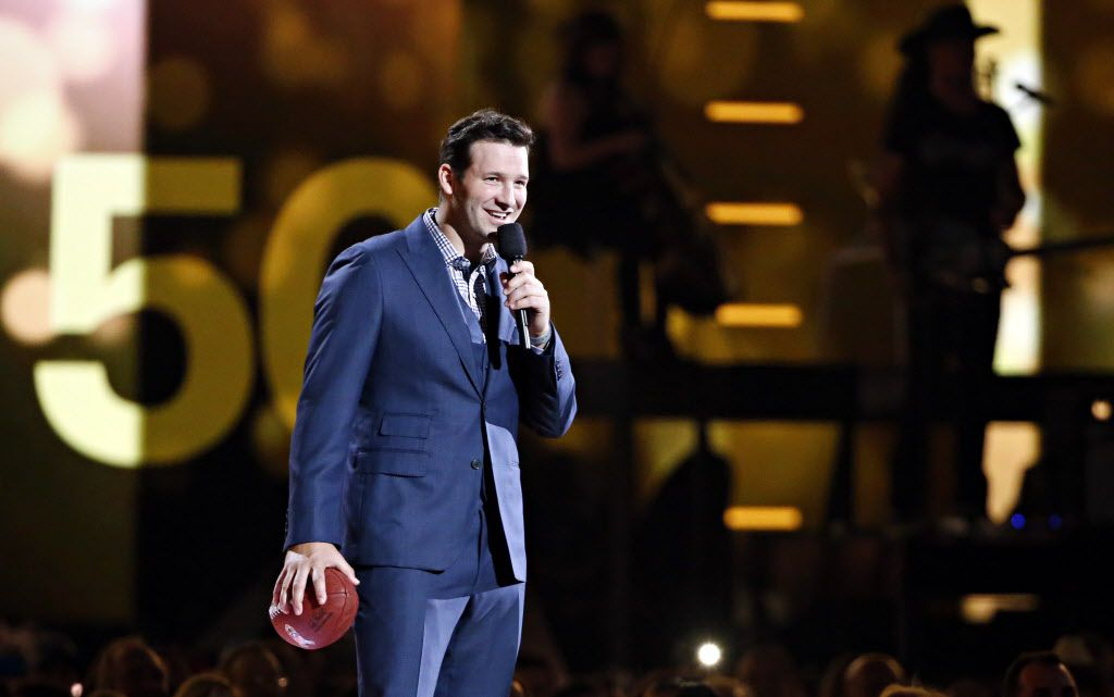 Dallas Cowboys quarterback Tony Romo stands on stage during the 2015 Academy of Country Music Awards Sunday, April 19, 2015 at AT&T Stadium in Arlington, Texas.