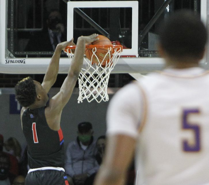 Duncanville forward Ron Holland (1) dunks to finish a fast break during first half action against Richardson. The two teams played their Class 6A state semifinal boys basketball playoff game at Moody Coliseum on the campus of SMU in Dallas on March 9, 2021. (Steve Hamm/ Special Contributor)
