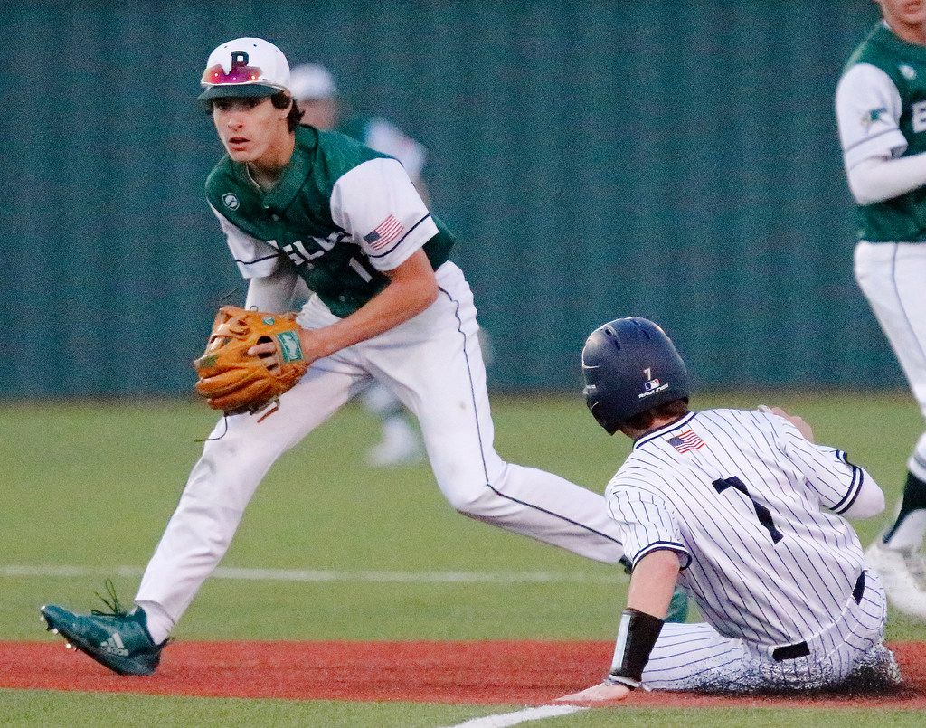 Prosper second baseman Chase Pendley (12) makes the force out on a fielder's choice on Allen third baseman Judson Arrington (7) at second base during the second inning as Allen High School hosted Prosper High School in a baseball game played in Allen on Thursday, April 18, 2019.  (Stewart F. House/Special Contributor)