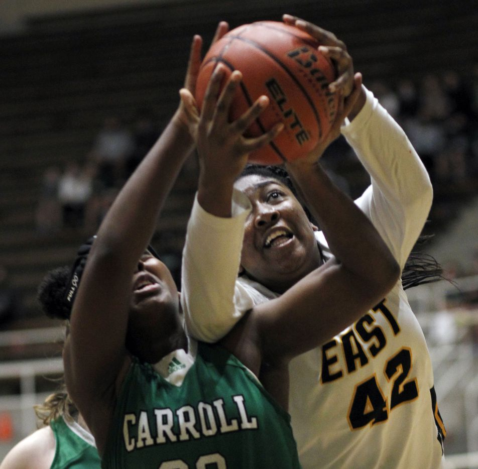 Plano East forward Idara Udo (42), right, battles for a rebound with Southlake Carroll forward Jordyn Sowell (33) during first half action. Udo was called for a foul on the play. The two teams played their Class 6A regional semifinal girls playoff basketball game at Loos Field House in Addison on February 27, 2021. (Steve Hamm/ Special Contributor)