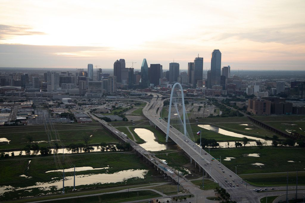 Margaret Hunt Hill Bridge (right) and the Ron Kirk Pedestrian bridge (left) as seen in front of the Dallas skyline on Friday, June 14, 2019. (Shaban Athuman/Staff Photographer)