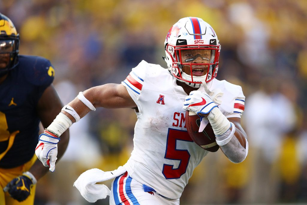 ANN ARBOR, MI - SEPTEMBER 15: Xavier Jones #5 of the Southern Methodist Mustangs outruns the tackle of Rashan Gary #3 of the Michigan Wolverines in the second half on September 15, 2018 at Michigan Stadium in Ann Arbor, Michigan. Michigan won the game 45-20. (Photo by Gregory Shamus/Getty Images)
