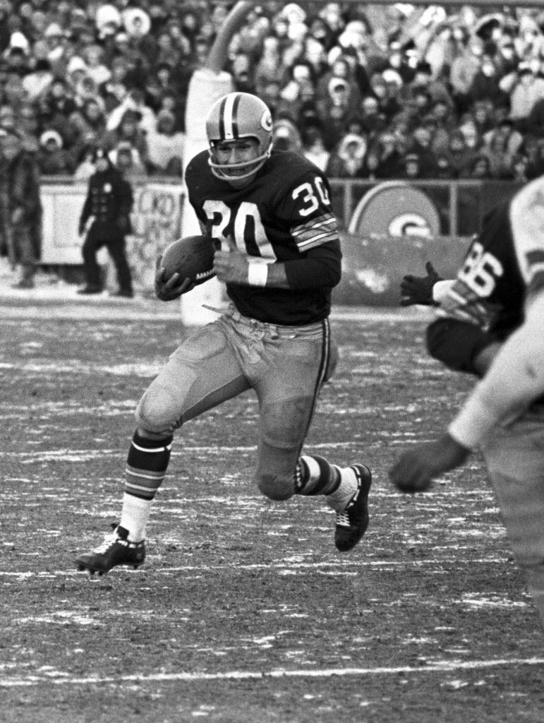 Chuck Mercein carries the ball in the 1967 NFL Championship Game between the Green Bay Packers and Dallas Cowboys.  Game time temperature was 13 degrees below zero.  The Packers won the game 21-17. (AP Photo by Vernon J. Biever)