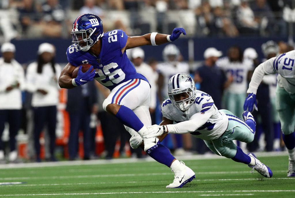 ARLINGTON, TEXAS - SEPTEMBER 08:  Saquon Barkley #26 of the New York Giants is tackled by Chidobe Awuzie #24 of the Dallas Cowboys at AT&T Stadium on September 08, 2019 in Arlington, Texas. (Photo by Ronald Martinez/Getty Images)