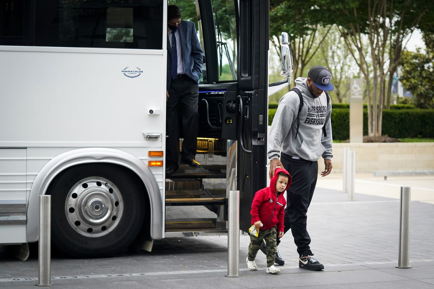 Dallas Cowboys first-round draft pick Micah Parsons, a linebacker from Penn State, arrives with his son Malcolm, 3, at The Star on Friday, April 30, 2021, in Frisco. (Smiley N. Pool/The Dallas Morning News)