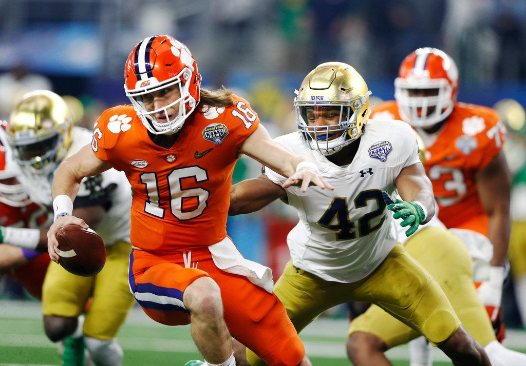FILE - Clemson quarterback Trevor Lawrence (16) spins away from Notre Dame defensive lineman Julian Okwara (42) during the first quarter of the Cotton Bowl Classic in Arlington on Saturday, Dec. 29, 2018.