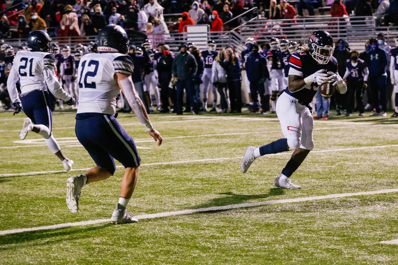 Denton Ryan's running back Keori Hicks runs in for a touchdown after catching a pass during the fourth quarter against Frisco Lone Star at the C.H. Collins Complex in Denton on Thursday, Dec. 4, 2020. Denton Ryan won, 35-21. (Juan Figueroa/ The Dallas Morning News)