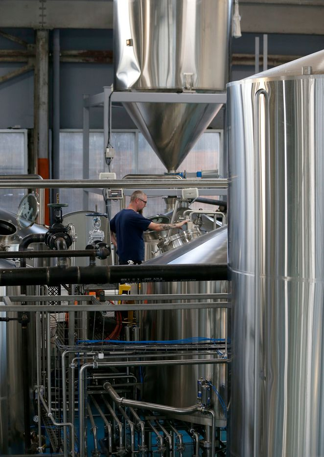 Brewer Justin Krey works at the new Four Corners Brewing Co. facility in the Cedars neighborhood in Dallas, Wednesday, Oct. 18, 2017.