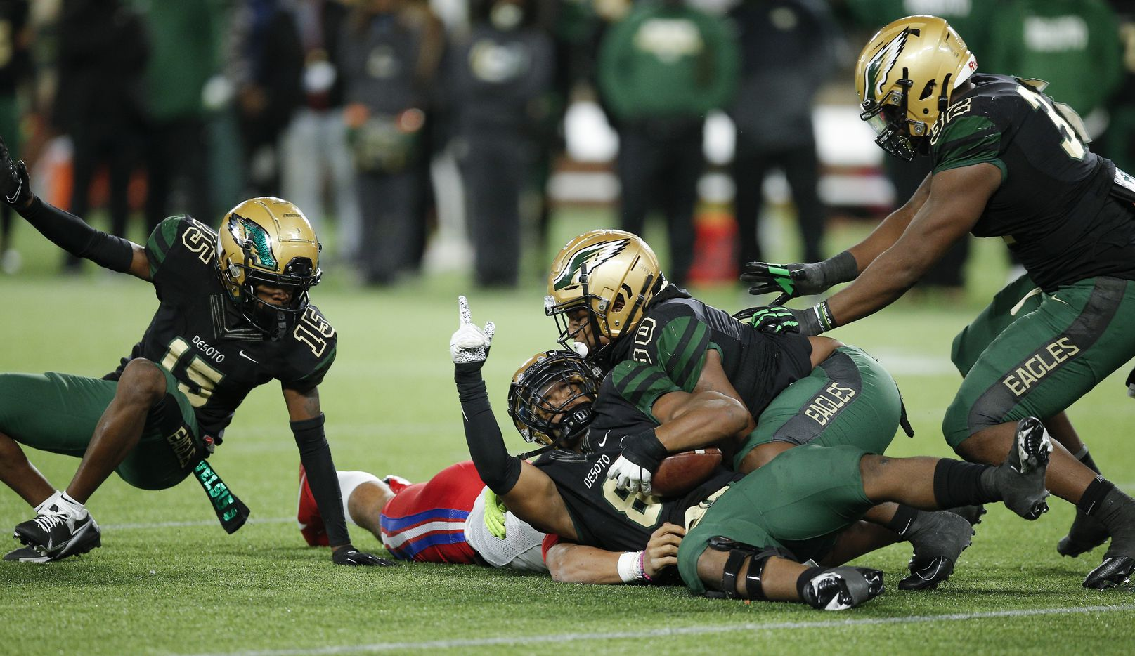 DeSoto linebacker D'verryon Foster (8) celebrates recovering a fumble by Duncanville senior quarterback Grayson James during the first half of a Class 6A Division I Region II final high school football game, Saturday, January 2, 2021.  Duncanville won 56-28. (Brandon Wade/Special Contributor)