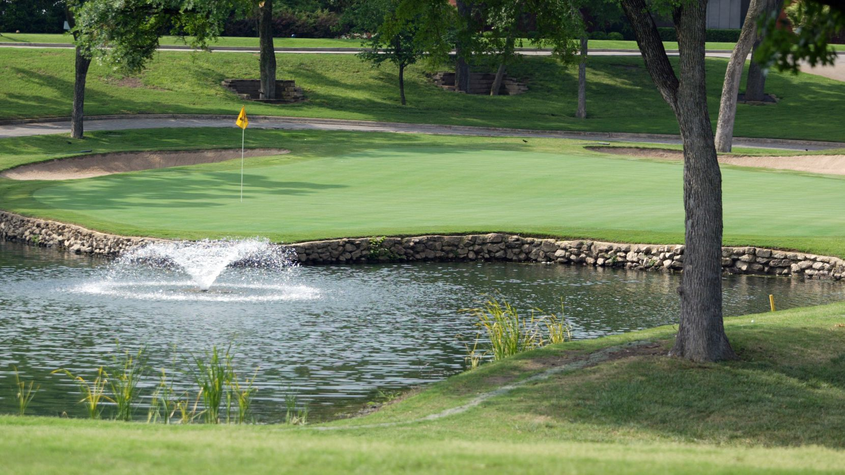 The approach shot to hole # 9 green, a 408 yard par 4, at the Colonial Country Club, Tuesday, April 6, 2003, in Fort Worth.