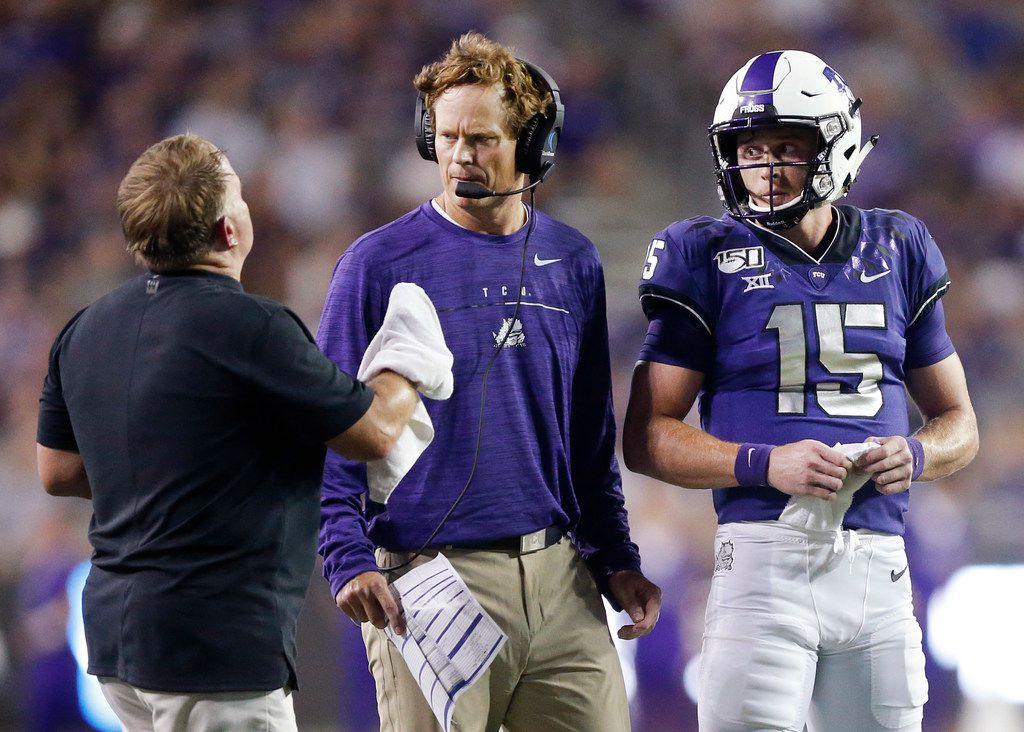 FILE - TCU co-offensive coordinator Sonny Cumbie (center) confers with head coach Gary Patterson (left) during a second-quarter timeout at Amon G. Carter Stadium in Fort Worth on Saturday, Aug. 31, 2019.