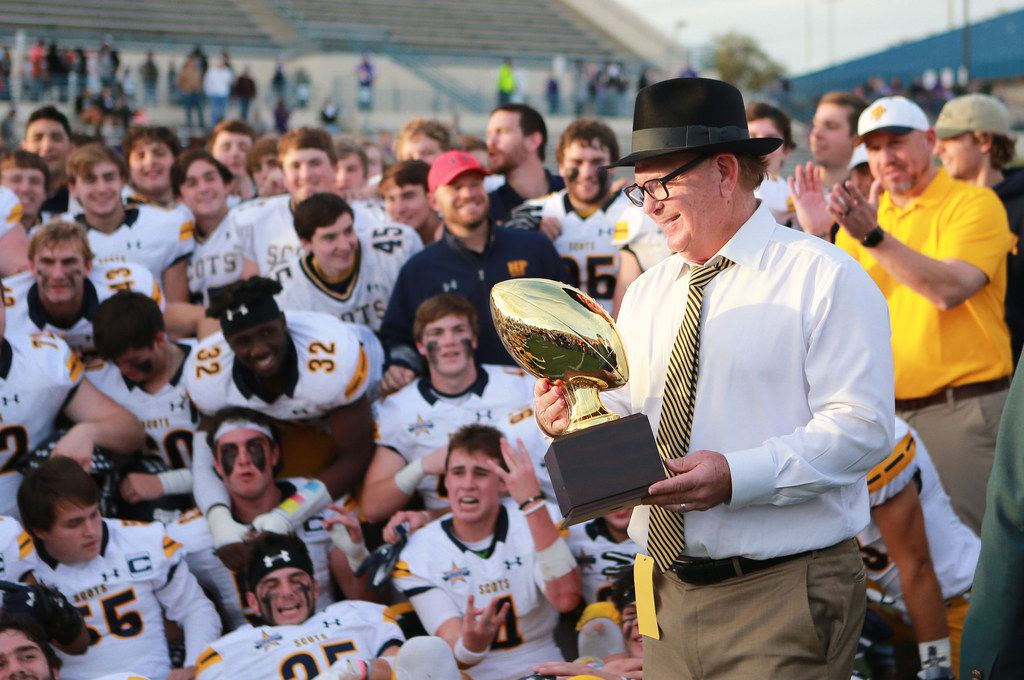 Highland Park football head coach Randy Allen bringing the trophy to Highland Park football p[layers during the second half of a 5A UIL DI-AREA playoff game between College Station Cougars Vs Highland Park Scots, on Saturday, November 24, 2018 in Waco, Texas. Special Contribution Jose Yau