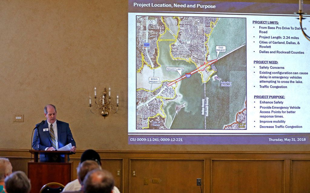 Mike Garrison talks about the Interstate Highway 30 frontage roads improvement project during a public hearing at Hella Shrine in Rowlett, Texas, Thursday, May 31, 2018. (Jae S. Lee/The Dallas Morning News)