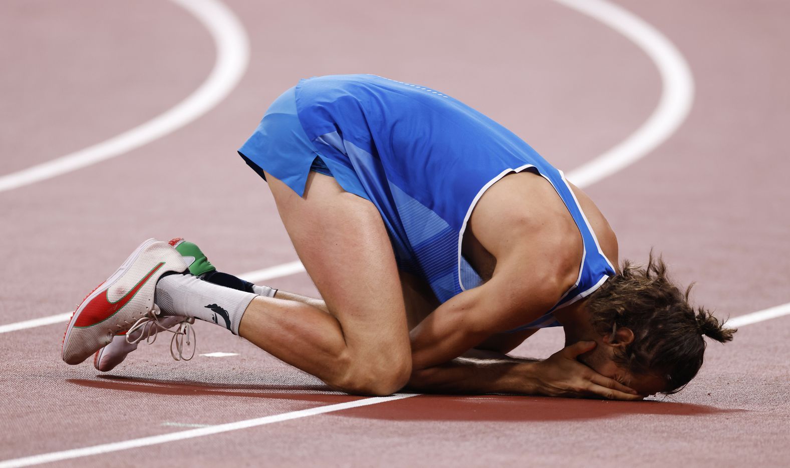 Italy's Gianmarco Tamberi celebrates after winning a gold medal in the men's high jump final during the postponed 2020 Tokyo Olympics at Olympic Stadium, on Sunday, August 1, 2021, in Tokyo, Japan. Tamberi will share a gold medal with Qatar's Mutaz Essa Barshim who also cleared 2.37 meters in the final. (Vernon Bryant/The Dallas Morning News)