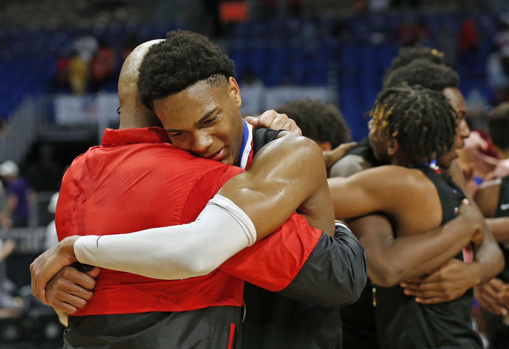 Duncanville Zhuric Phelps #0 is congratulated by Duncanville head coach David Peavy. UIL boys Class 6A basketball state championship game between Duncanville and Austin Westlake on Saturday, March 13, 2021 at the Alamodome.