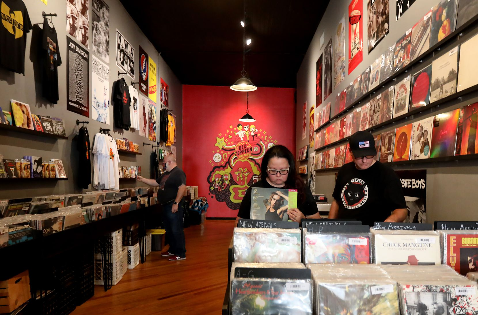 Ben and Rose Sloma look through records at Red Zeppelin, a record store in downtown McKinney.