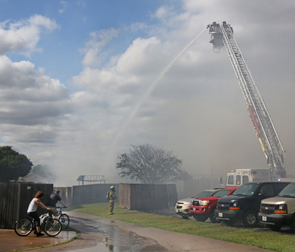 Firefighters battle a blaze at the Appleseed Academy in Mesquite.