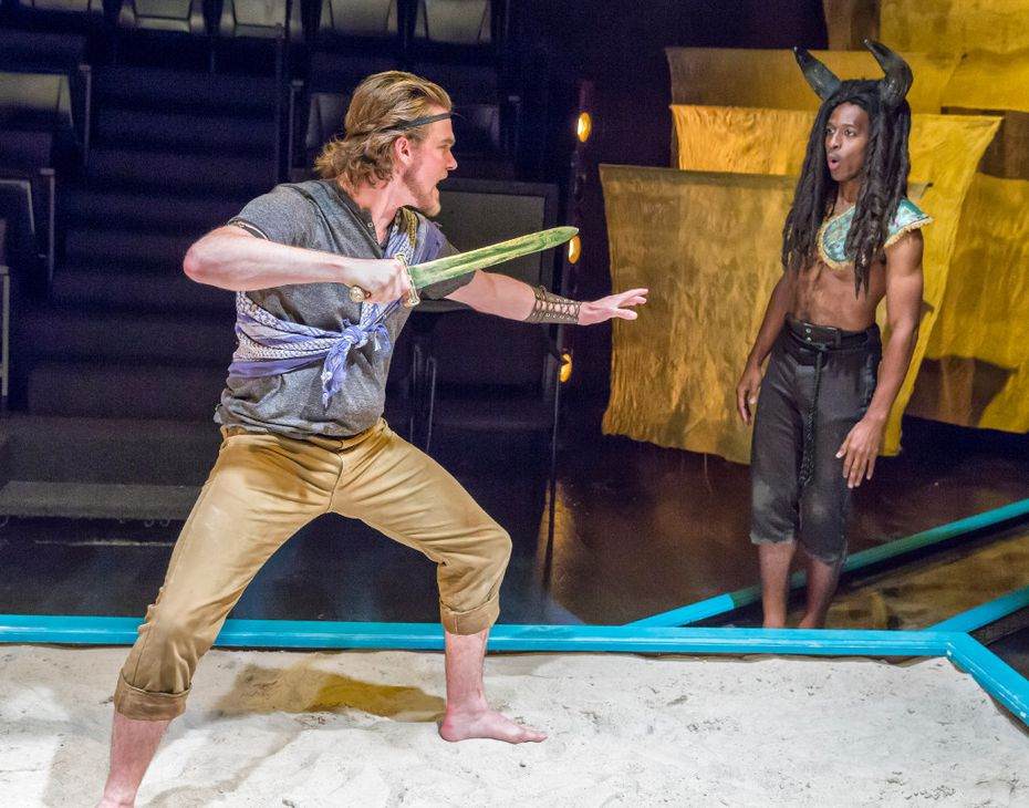 Kyle Igneczi as Theseus, left, and Darren McElroy as The Minotaur in the regional premiere  at Theatre Three in Dallas.