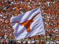 The Texas Longhorns flag is run across the field after a score during the second half of an NCAA football game against Oklahoma at the Cotton Bowl on Saturday, Oct. 12, 2019, in Dallas.