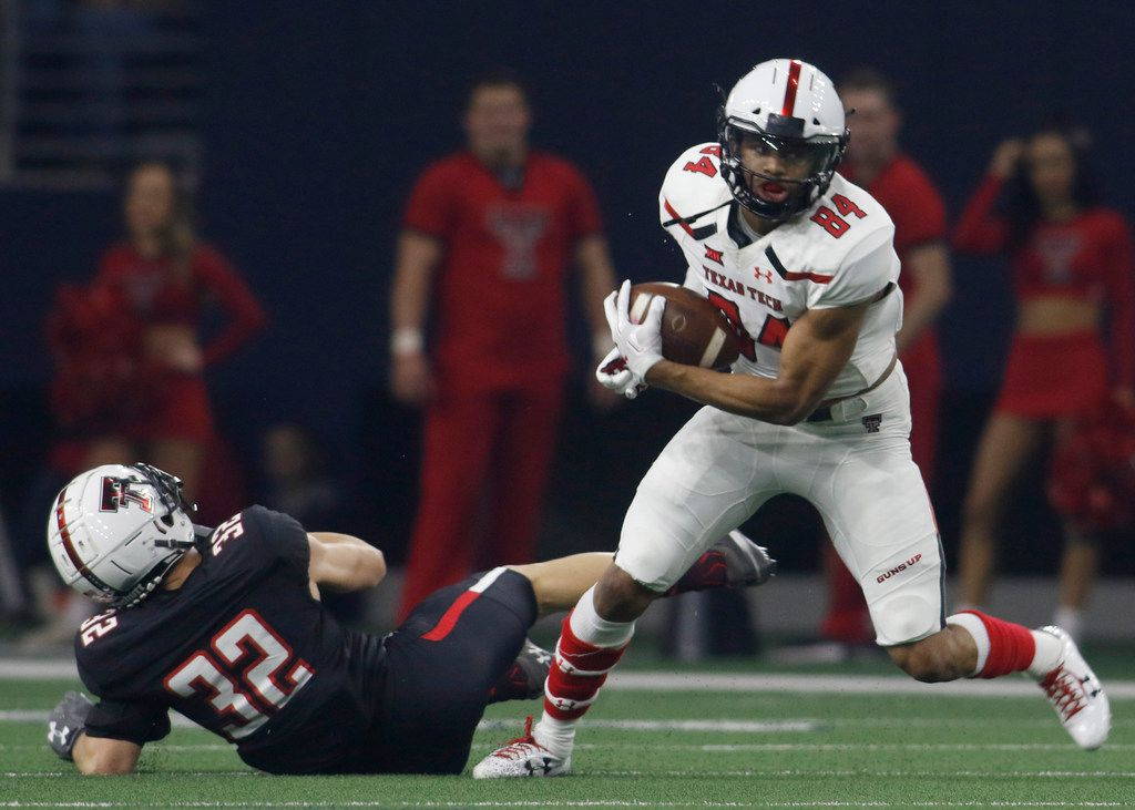 Texas Tech receiver Erik Ezukanma (84) pulls in a pass and is able to elude the defensive effort of defensive back Jake Kirkpatrick (32) to add yards after the catch for a first down during first half play. The annual spring game for the Texas Tech football program was held at The Star in Frisco on April 13, 2019. (Steve Hamm/ Special Contributor)