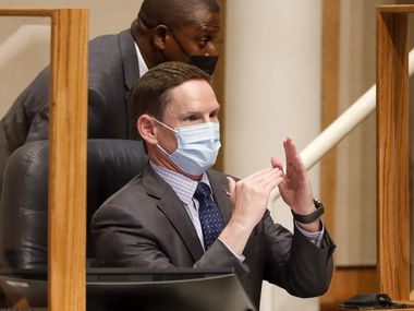 Dallas County Judge Clay Jenkins motions during a Dallas County Commissioners Court meeting on Tuesday, Aug. 3, 2021, in Dallas. (Elias Valverde II/The Dallas Morning News)