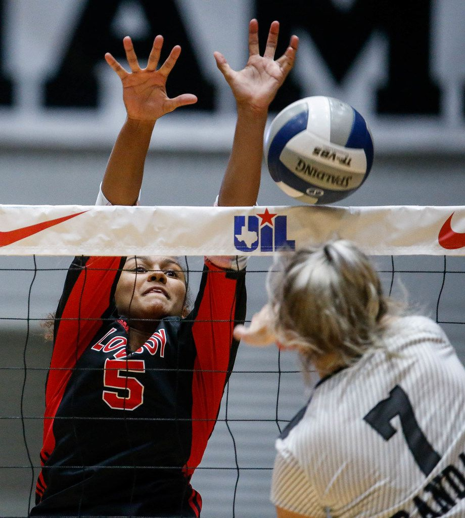 LovejoyÕs Cecily Bramschreiber  (5) attempts to block Canyon RandallÕs Kiar Parker (7) hit in the first set of a class 5A volleyball state semifinal match at the Curtis Culwell Center in Garland, on Saturday, November 23, 2019. Lovejoy won the first set 27-25. (Juan Figueroa/The Dallas Morning News)