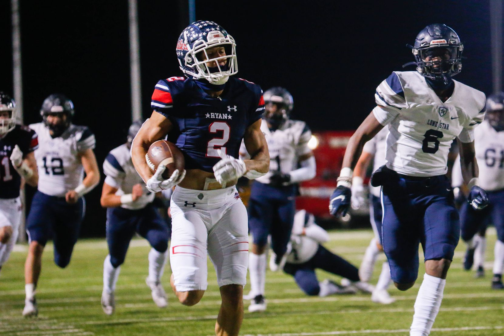 Denton Ryan's Billy Bowman Jr. (2) runs the ball during the second quarter of a football game against Frisco Lone Star at the C.H. Collins Complex in Denton on Thursday, Dec. 4, 2020. The game is tied at halftime, 14-14. (Juan Figueroa/ The Dallas Morning News)