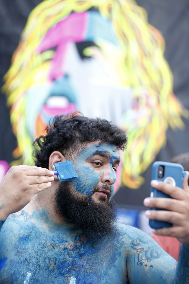 Joshua Akiva of Dallas paints himself in an attempt to get free tickets to the last home game of the season between the Dallas Mavericks and Phoenix Suns at American Airlines Center in Dallas on Tuesday, April 9, 2019. (Vernon Bryant/The Dallas Morning News)