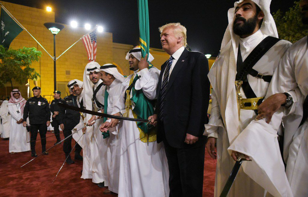 US President Donald Trump joins dancers with swords at a welcome ceremony ahead of a banquet at the Murabba Palace in Riyadh on May 20, 2017. / AFP PHOTO / MANDEL NGANMANDEL NGAN/AFP/Getty Images