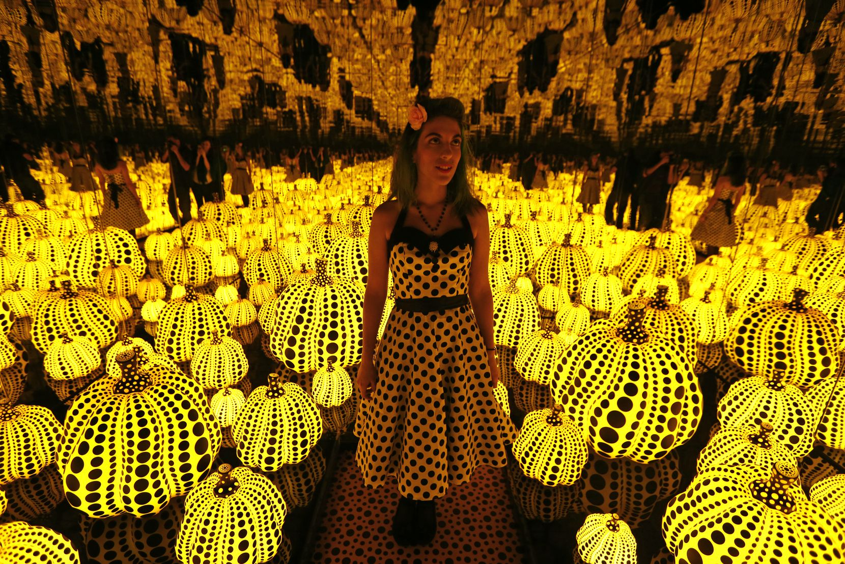 """Lyza Hernandez admired Yayoi Kusama's installation """"All the Eternal Love I Have for the Pumpkins"""" at the Dallas Museum of Art in September 2017."""