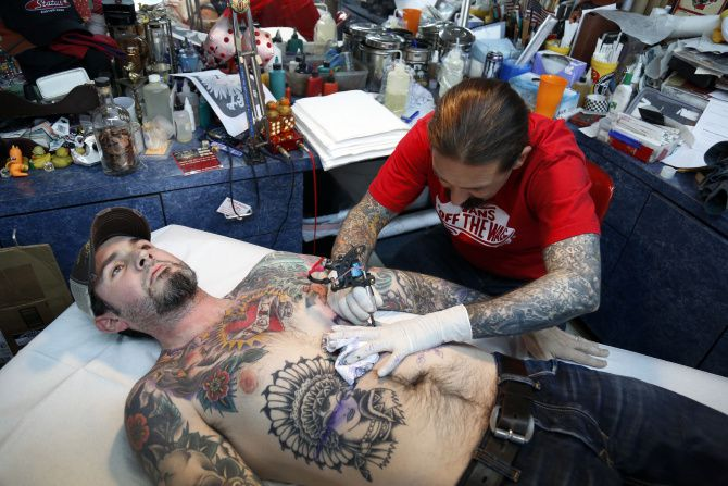 Oliver Peck, with Joe McAmis at his shop in Deep Ellum,  did 415 tattoos in 24 hours In June 2008, breaking the Guinness world record of 400. Phoenix's Hollis Cantrell eventually squashed the record, doing 808 tattoos in a day.