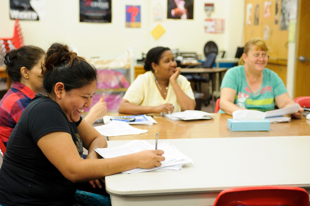 Erika Calleja of Morelos, Mexico, laughs at a comment made by her tutor while attending class with Elifenesh Bizuenh of Addis Abela, Ethiopia, (middle) and Graciela Perez of Chihuahua, Mexico, (far right) during a Lincoln Literacy class at Culler Middle School in Lincoln, Neb. on Wednesday, July 12, 2017. Lincoln Literacy is a nonprofit formed to teach the English language to immigrants and refugees arriving in Lincoln. (Matt Ryerson/Special Contributor)