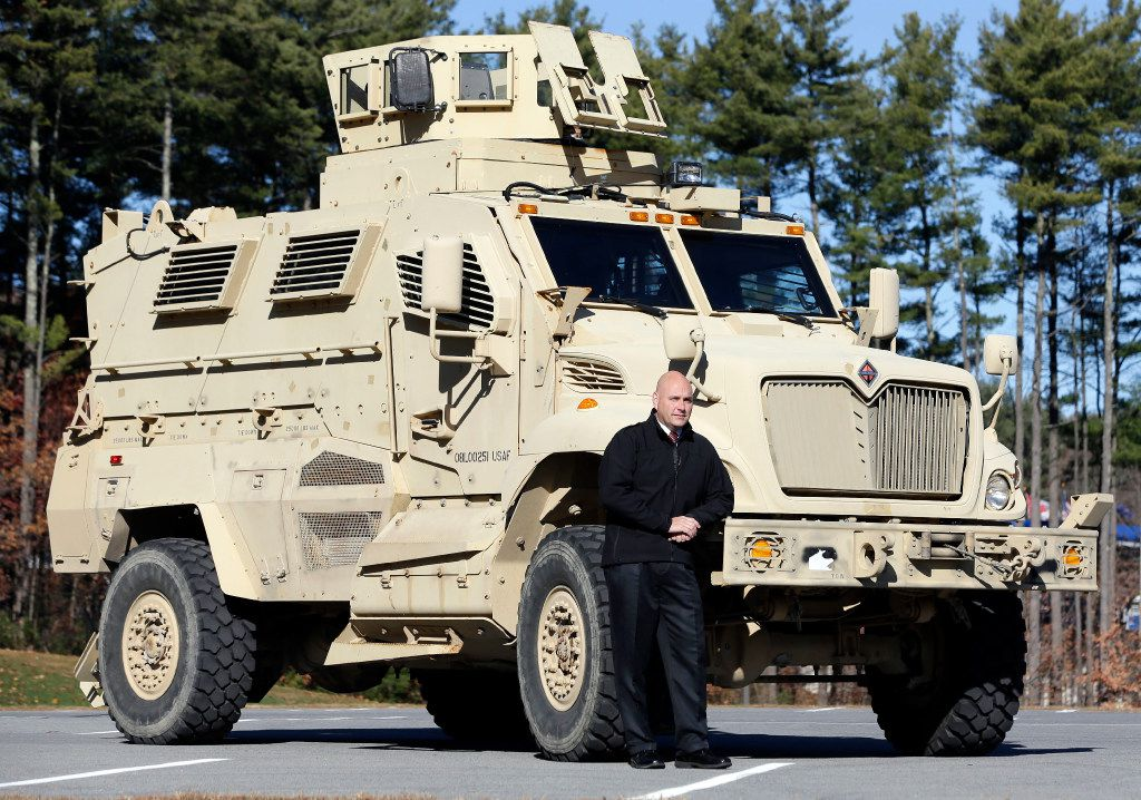 Warren County Undersheriff Shawn Lamouree poses in front the department's mine resistant ambush protected vehicle, or MRAP, in Queensbury, N.Y. The hulking vehicles, built for about $500,000 each, are among the biggest pieces of equipment that the Defense Department is giving to law enforcement agencies under a national military surplus program. (Mike Groll/The Associated Press)