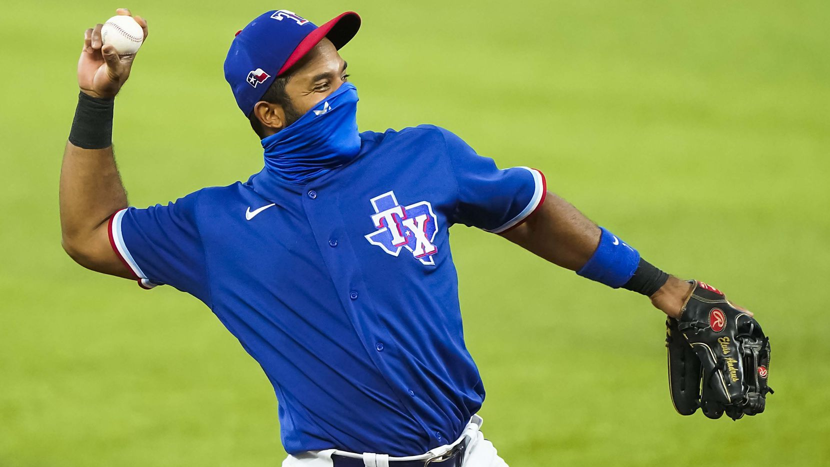Texas Rangers shortstop Elvis Andrus donned a face mask while warming up before an exhibition game against the Colorado Rockies at Globe Life Field on Tuesday, July 21, 2020.