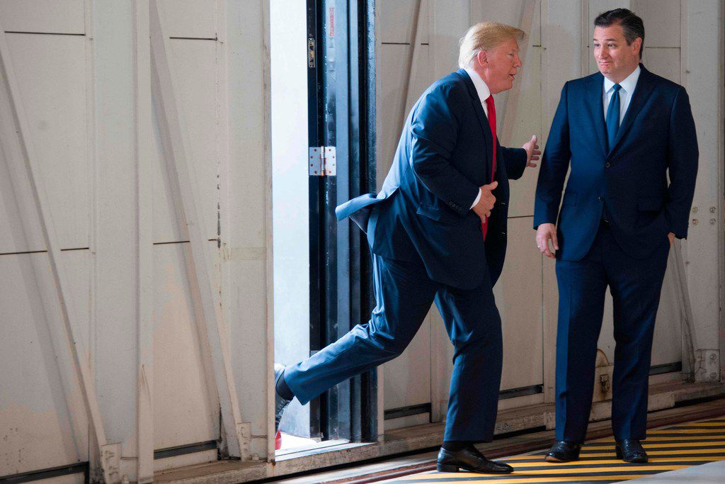 Sen. Ted Cruz greets President Donald Trump at Ellington Field Joint Reserve Base in Houston on May 31, 2018. (Jim Watson/Agence France-Presse)