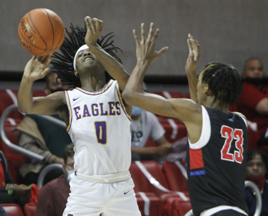 Richardson guard Jaylon Barnett (0) gets off a desperation last second shot as he is defended by Duncanville forward Cameron Barnes (23). Barnett failed to score on the final play of the first half. The two teams played their Class 6A state semifinal boys basketball playoff game at Moody Coliseum on the campus of SMU in Dallas on March 9, 2021. (Steve Hamm/ Special Contributor)