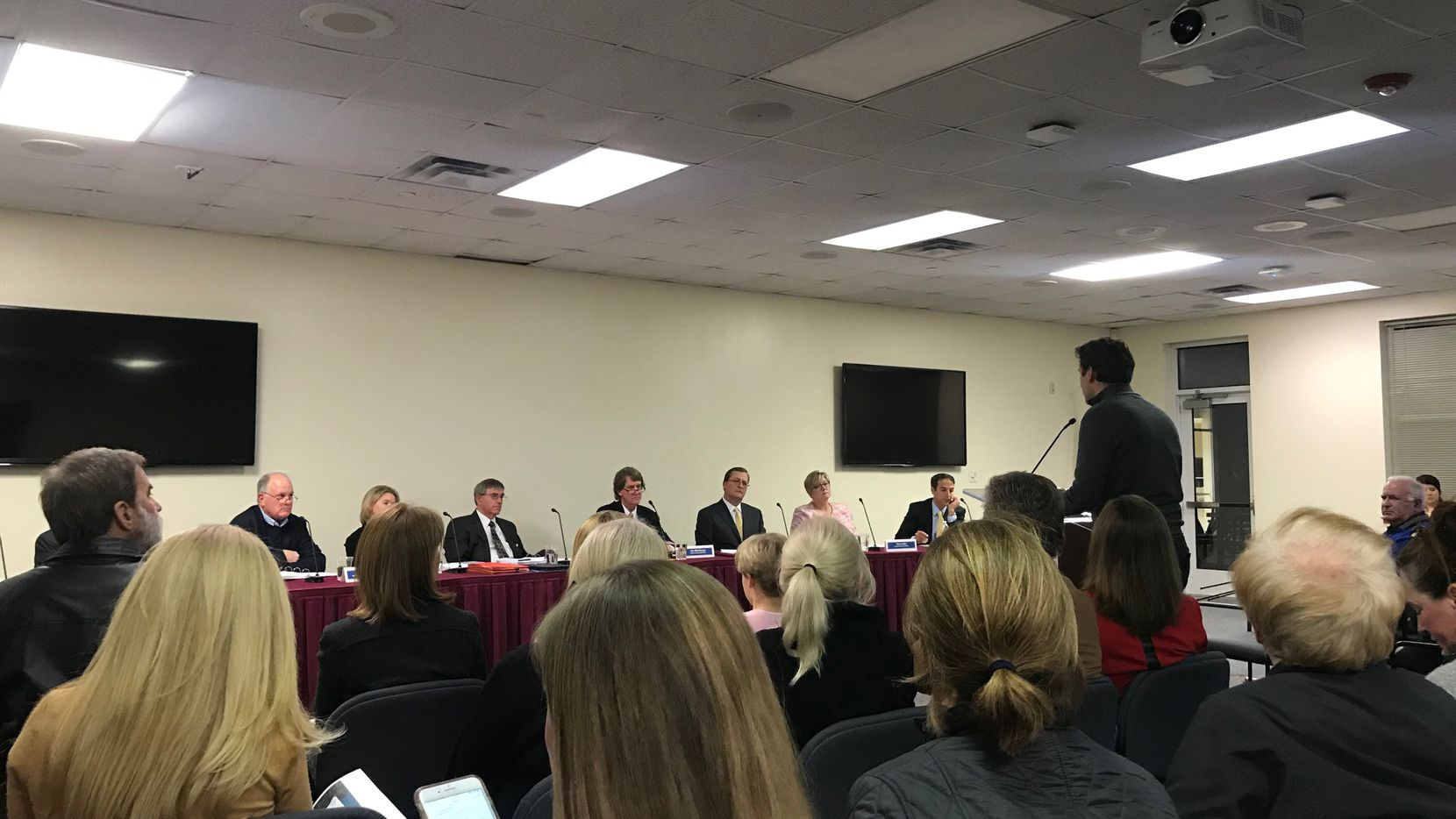 About 20 parents and residents showed up at Tuesday night's board meeting to ask the district to hold off on plans to remake Bradfield and Hyer elementary schools.