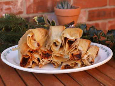 Mely Martinez shows off her homemade tamales at her home in Frisco