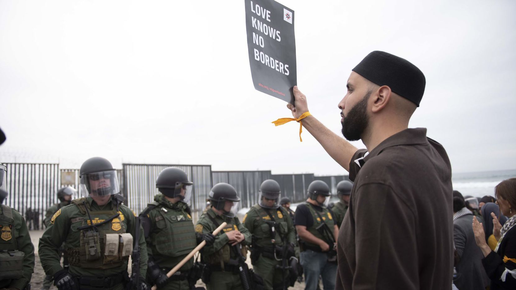 Imam Omar Suleiman protests U.S. immigration policies with a group of demonstrators at the border between San Diego, Calif.,  and Tijuana, Mexico.
