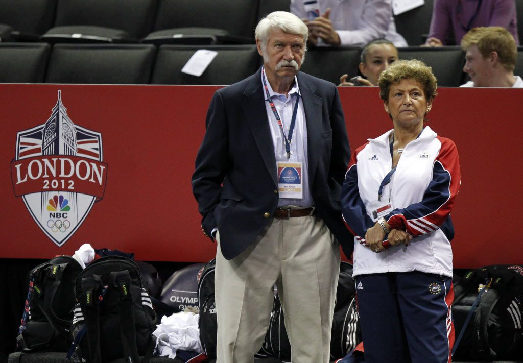 Bela and Martha Karolyi watch as athletes practice in a warmup session before the first round of the Women's Olympic Trials Gymnastics on June 29, 2012, in San Jose.