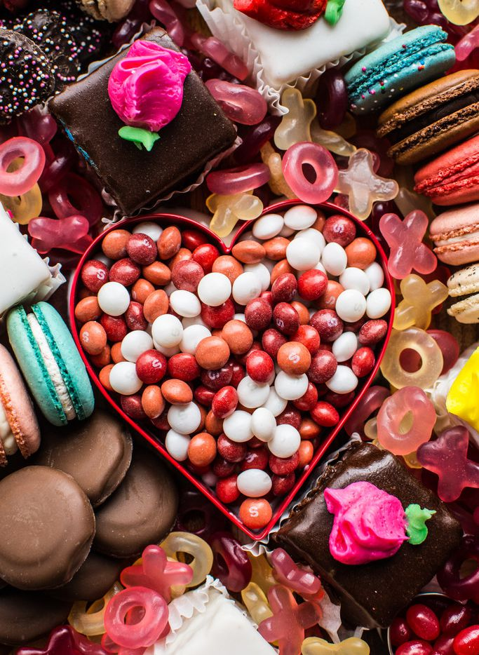 Petit fours, macarons, jelly beans and more comprise a Valentine's Day dessert board