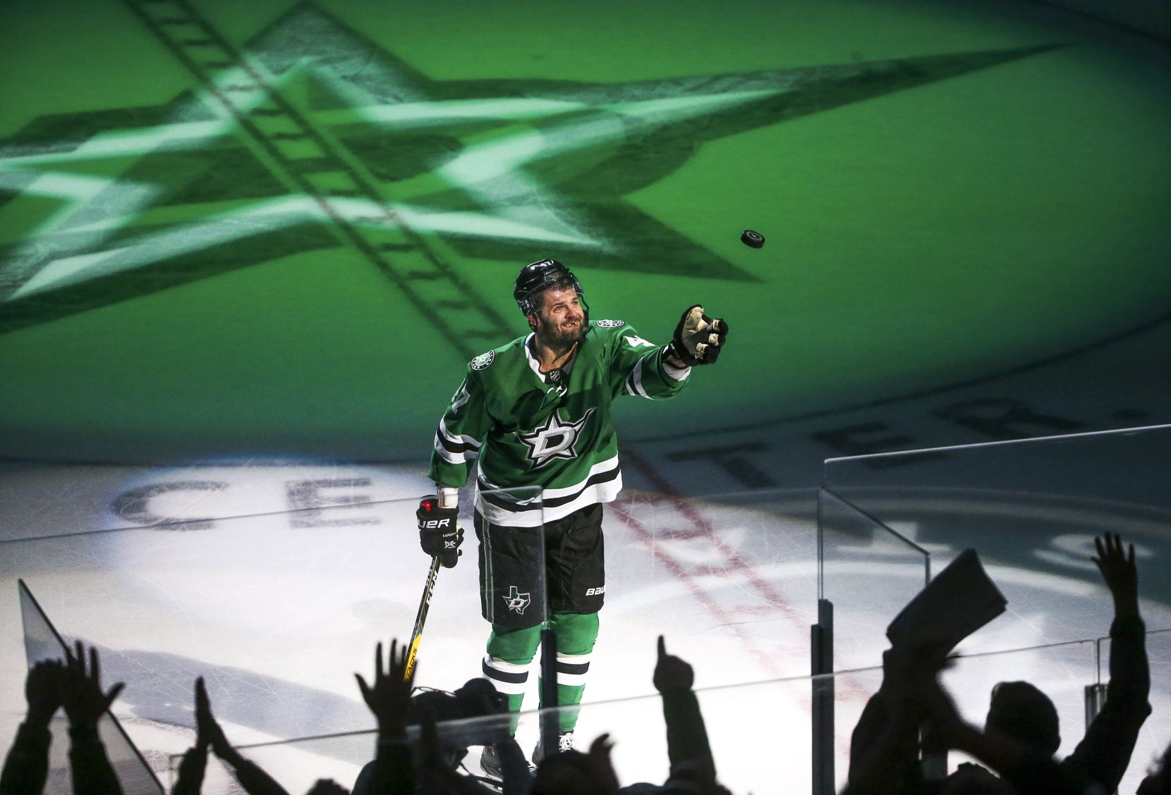 Dallas Stars right wing Alexander Radulov (47) gives a fan a game puck following the Stars 6-2 win against Philadelphia Flyers at American Airlines Center in Dallas on Tuesday, April 2, 2019.