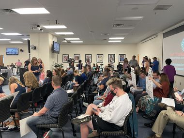 People gather for Fort Worth ISD's special board meeting at the Fort Worth Professional Development Center on Tuesday, August 17, 2021. Trustees voted 6-2 to join the lawsuit fighting Gov. Greg Abbott's executive order. One board member abstained.