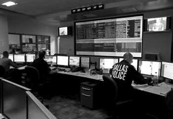 This photo from The Dallas Morning News archives shows Dallas police in their fusion center. At its opening more than a decade ago, police said the center would play a key role in serving as the 21st-century version of crime watch programs.
