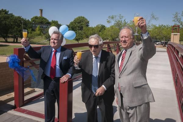 Thomas W. Keefe, President of the University of Dallas; Eugene Vilfordi; and Robert M.Galecke, UD Executive Vice President, raise a toast after a ribbon cutting for the Eugene Vilfordi Plaza at the University of Dallas.