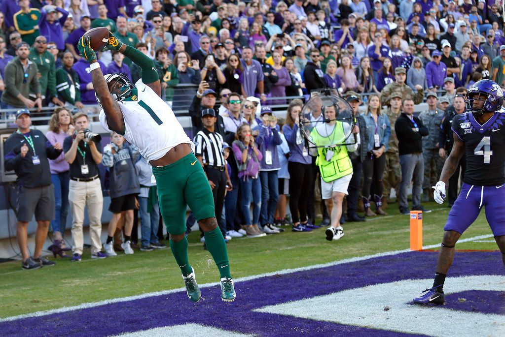 Baylor cornerback Grayland Arnold (1) intercepts the ball as TCU safety Keenan Reed (4) looks on to end the game in the third overtime of an NCAA college football game, Saturday, Nov. 9, 2019, in Fort Worth, Texas. Baylor won 29-23 in triple overtime.