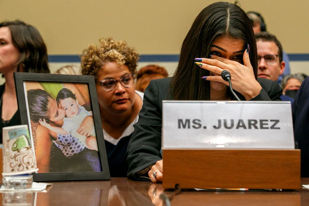 Yazmin Juárez, reacts as a photo of her daughter Mariee, who died after being released from detention by U.S. Immigration and Customs Enforcement, is placed next to her at a House Oversight subcommittee hearing on treatment of immigrant children at the southern border on July 10, 2019.