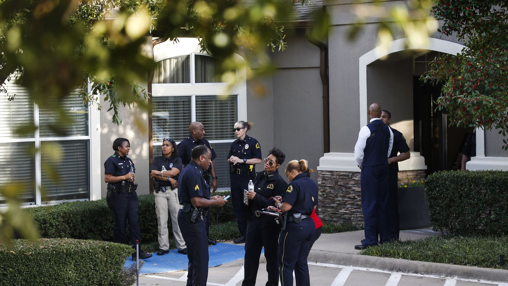 Dallas police investigate where two children and two adults were found shot to death at a Staybridge Suites near Keller Springs Road and the Dallas North Tollway on Tuesday, March 10, 2020 in Dallas. (Ryan Michalesko/The Dallas Morning News)